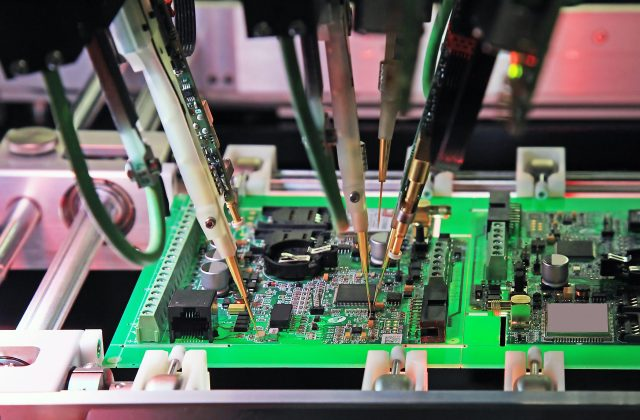 The production line of electronic board with microchip.The electronics board production process.
